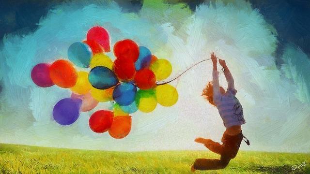 chlapec při výskoku s létajícími balónky.jpg